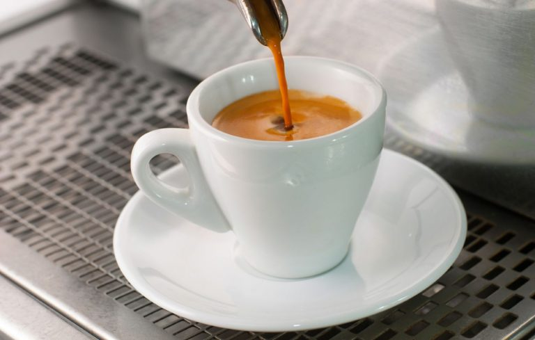 Freshly brewed espresso in a small porcelain cup