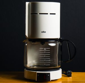 White Braun drip coffee maker with a glass carafe